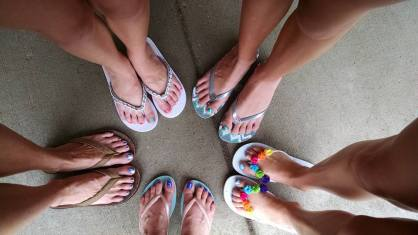 Pedicures (mine are on the bottom right--the white flip flops with the rainbow of flowers)