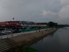 The historic downtown from a bridge above The Chin River