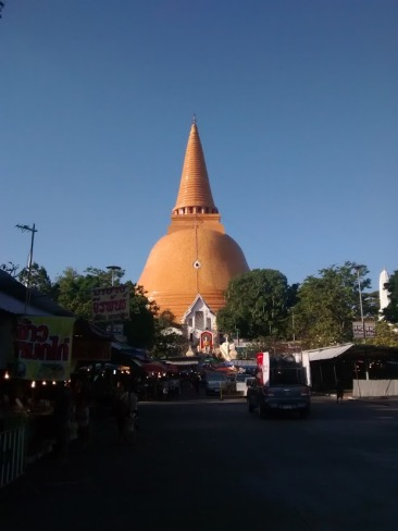 Wat Phra Pathom Chedi pictured behind a local market